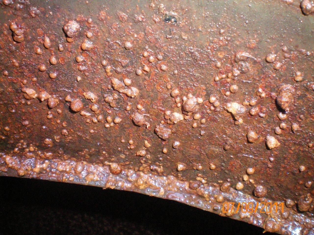 Corrosion craters.