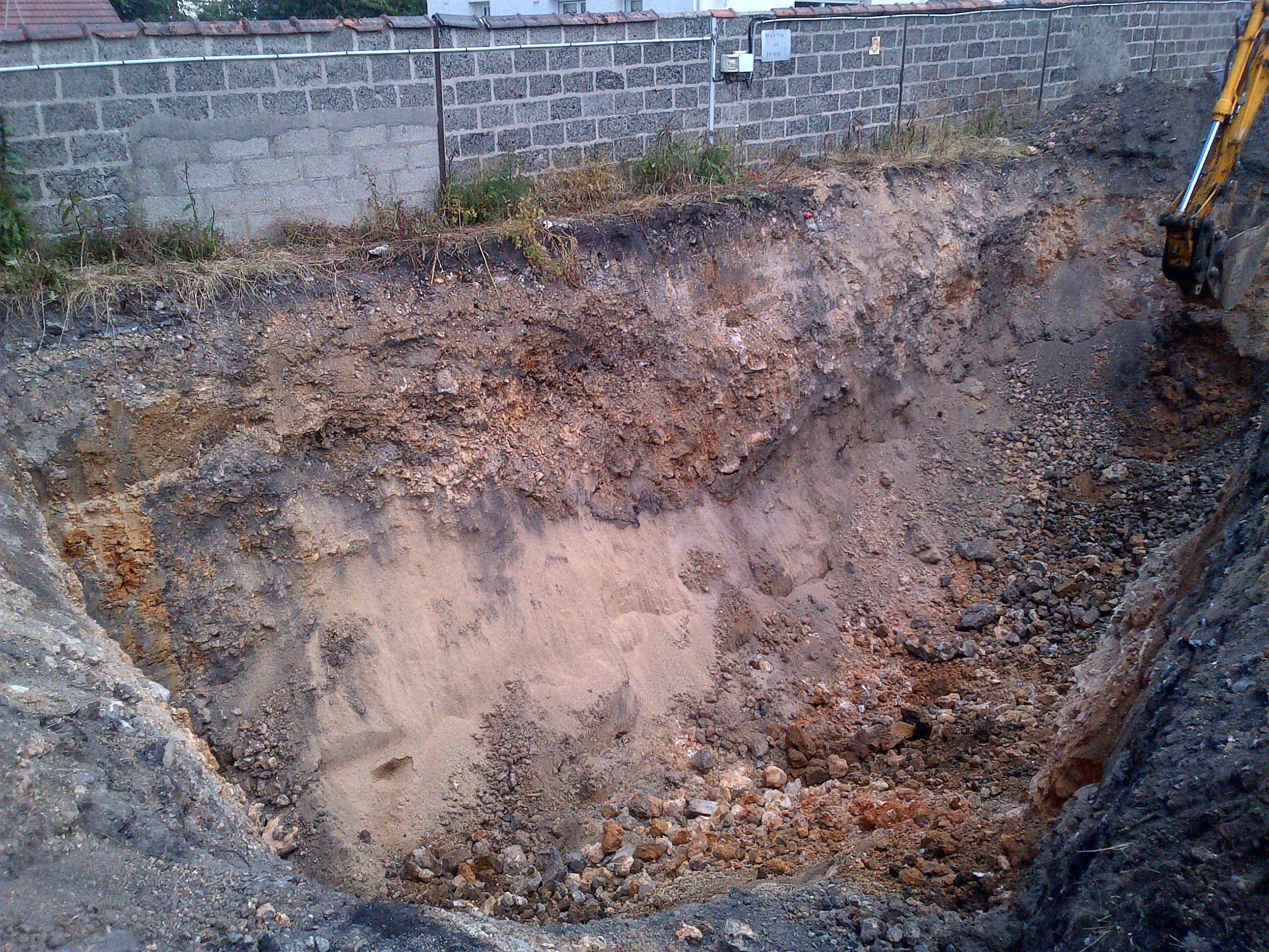 Digging of contaminated land.