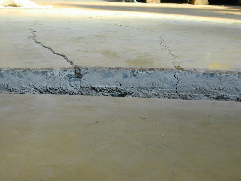 Pavement heaving due to swelling soils.